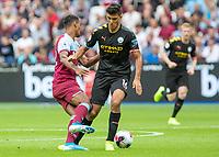 Football - 2019 / 2020 Premier League - West Ham United vs. Manchester City<br /> <br /> Premier League debut players clash as they battle for the ball Rodrigo (Manchester City) and Sebastien Haller (West Ham United) at the London Stadium<br /> <br /> COLORSPORT/DANIEL BEARHAM