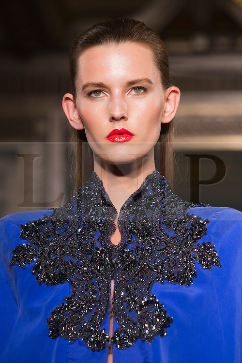 © Licensed to London News Pictures. 14/09/2013. London, England. A model walks the catwalk at the Ashley Isham show at Fashion Scout during London Fashion Week. Photo credit: Bettina Strenske/LNP