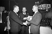 05/04/1966<br /> 04/05/1966<br /> 05 April 1966<br /> Presentation of Awards for entries in the N.A.I.D.A. St Patrick's Day Parade at the Shelbourne Hotel, Dublin. Picture shows Mr. L.V. Nolan, (left) President of the N.A.I.D.A., presenting the bronze medal award to Thompson, Barnett and Co. Ltd. accepted by Mr. C.J. Thompson, (27a Terenure Road, Dublin).