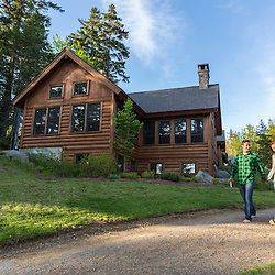 A young couple walk to their cabin at the Appalachian Mountain Club's Gorman Chairback Lodge. Near Greenville, Maine.