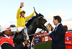 Durban 07-07-18 :Do it again, the Vodacom July winner with his jocky Antony Marcus celebrating, as the owner horse owner Jack Mitchel <br /> hugs.<br /> PICTURE BONGANI MBATHA AFRICAN NEWS AGENCY (AMA)