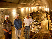Alf Burtleson (center) stands with his partners Dale Wondergem and Jim Curry where they are expanding a wine cave belonging to Flora Springs Winery in Napa Valley, California.