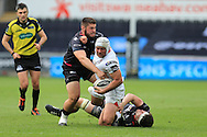 Rory Best of Ulster © is hauled down by Gareth Thomas (l) and Rory Thornton of the Ospreys. Guinness Pro12 rugby match, Ospreys v Ulster Rugby at the Liberty Stadium in Swansea, South Wales on Saturday 7th May 2016.<br /> pic by  Andrew Orchard, Andrew Orchard sports photography.