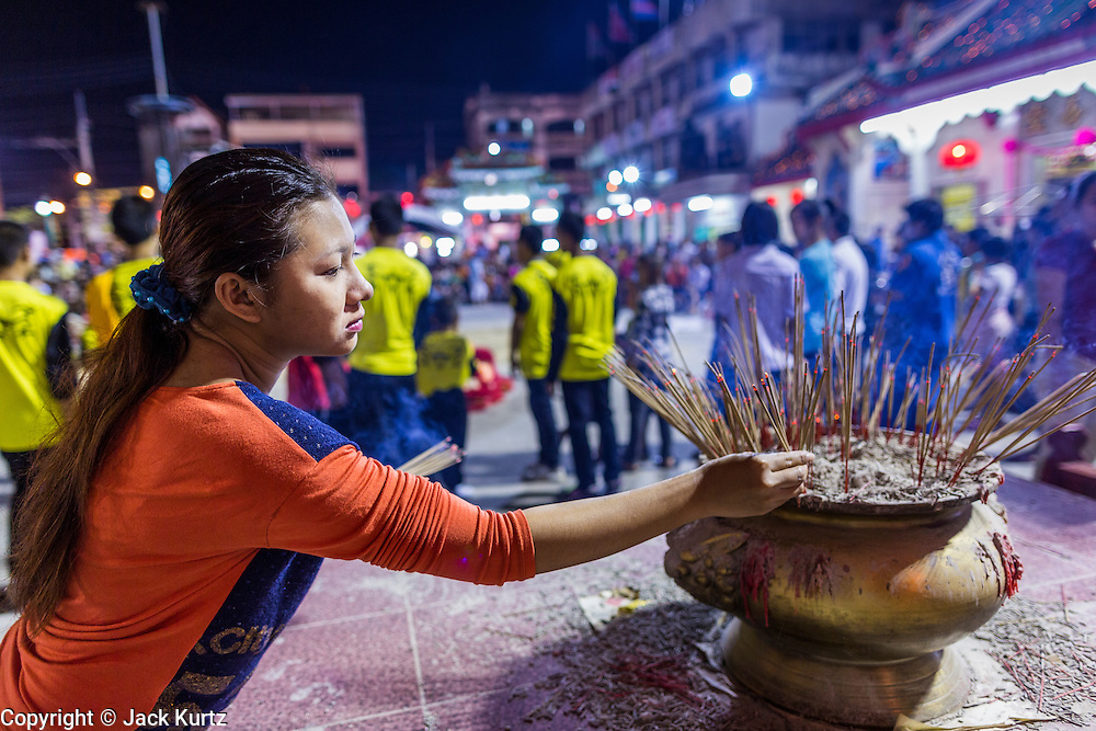 09 FEBRUARY 2014 - HAT YAI, SONGKHLA, THAILAND: People pray in front of the temple during Lunar New Year in the Tong Sia Siang Tueng temple in Hat Yai. Hat Yai was originally settled by Chinese immigrants and still has a large ethnic Chinese population. Chinese holidays, especially Lunar New Year (Tet) and the Vegetarian Festival are important citywide holidays.     PHOTO BY JACK KURTZ