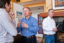 Rod Taylor of Uncommon Journeys meets with guests at his Whitehorse homestead lodge