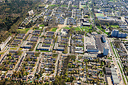 Nederland, Drenthe, Emmen, 01-05-2013; Angelslo, nieuwbouwwijk uit de jaren zestig van de twintigste eeuw, wederopbouwperiode. Rechts de hoofdontsluiting, de Statenweg, foto in oostelijke richting.<br /> Kenmerkend is de indeling in buurten en woonerven, scheiding van functies (wonen, werken, verkeer). Rationalistische architectuur, groen en ruimte. <br /> New residential area in Emmen built in the sixties during the period of Reconstruction after World War II, characteristic of the division into neighborhoods and residential precincts, separation of functions (living, working, traffic). Rationalist architecture.<br /> <br /> luchtfoto (toeslag op standard tarieven)<br /> aerial photo (additional fee required)<br /> copyright foto/photo Siebe Swart