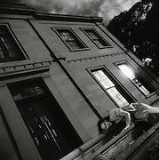 Woman on Steps of Heritage Mansion near Maitland, NSW, Australia