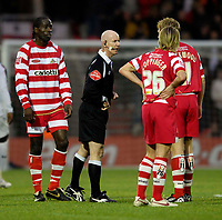 Photo: Jed Wee/Sportsbeat Images.<br />Doncaster Rovers v Bolton Wanderers. The FA Cup. 06/01/2007.<br /><br />Doncaster listen to referee Dermott Gallager's explanation following Bolton's third goal.