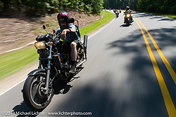 """Coast-to-coast """"Stampeder"""" Jeremiah Jack takes a ride Saturday morning during the Smokeout. Rockingham, NC. USA. June 20, 2015.  Photography ©2015 Michael Lichter."""