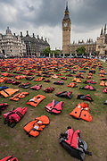 Refugees & charities create a 'lifejacket graveyard' in Parliament Square as world leaders meet at United Nations Migration Summit in New York. The display is made up of 2500 lifejackets, of which 625 were used by children, and was organised by Snappin' Turtle Productions and supported by the Mayor's office.