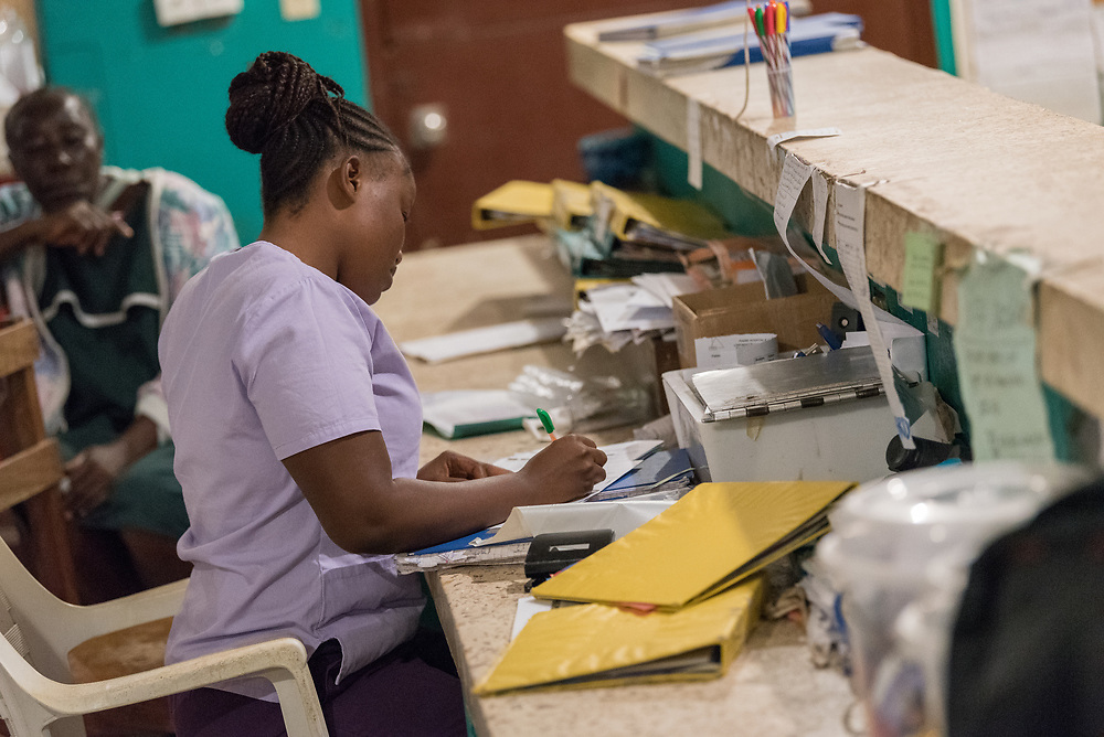 2 November 2019, Ganta, Liberia: A nurse takes notes at Phebe Hospital. Located in Bong county, Phebe Hospital serves tens of thousands of patients each year. It is a government referral hospital for which the Lutheran Church in Liberia provides managerial resources.