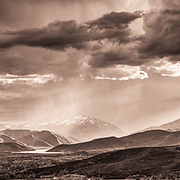 The Heber Valley and Deer Creek Reservoir shine during a dramatic spring storm.