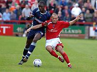 Photo: Paul Greenwood.<br />Accrington Stanley v Swindon Town. Coca Cola League 2. 07/10/2006.<br />Swindon's Fola Onibuje (L) battles with Accrington's Leam Richardson.