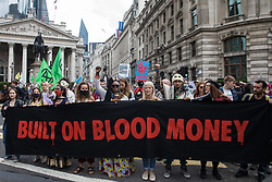 London, UK. 27th August, 2021. Environmental activists from Extinction Rebellion stage a Blood Money March through the City of London during the fifth day of Impossible Rebellion protests. Extinction Rebellion were intending to highlight financial institutions funding fossil fuel projects, especially in the Global South, as well as law firms and institutions which facilitate them, whilst calling on the UK government to cease all new fossil fuel investment with immediate effect.