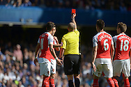 Referee Michael  Dean gives a red card to Gabriel of Arsenal for an incident with Diego Costa of Chelsea. Barclays Premier League match, Chelsea v Arsenal at Stamford Bridge in London on Saturday 19th September 2015.<br /> pic by John Patrick Fletcher, Andrew Orchard sports photography.