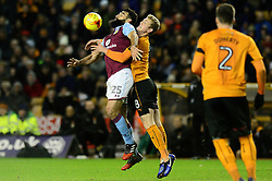 Mile Jedinak of Aston Villa challenges for the ball in the air with George Saville of Wolverhampton Wanderers - Mandatory by-line: Dougie Allward/JMP - 14/01/2017 - FOOTBALL - Molineux - Wolverhampton, England - Wolverhampton Wanderers v Aston Villa - Sky Bet Championship