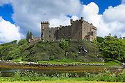 Highland fortress Dunvegan Castle, the Highlands ancestral home of the MacLeod clan, and loch on the Isle of Skye, Scotland