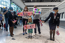 Licensed to London News Pictures. 09/08/202. London, UK. Families wave flags and posters as Olympic athletes arrive at London Heathrow T5. Team GB celebrate 22 gold medals in one of the most successful Olympics on record. Jason and Laura Kenny also became Britain's most successful Olympic athletes with Jason clinching his 7th gold and Laura winning her 5th gold including a gold and silver at the Tokyo games. Photo credit: Alex Lentati/LNP