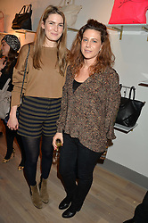 Left to right, ANTONIA FRASER and FRANCESCA VERSACE at a party hosted by Melissa Del Bono to celebrate the launch of her Meli Melo flagship store at 324 Portobello Road, London W10 on 28th November 2013.