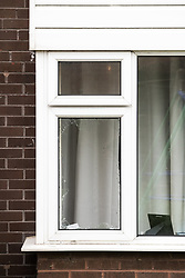 © Licensed to London News Pictures . 26/07/2017 . Oldham , UK . Broken ground floor window in back garden of the house at the scene of an armed siege that began at 3.15am on Tuesday 25th July in a house on Pemberton Way in Shaw . A man named locally as Marc Schofield is reported to be holding a woman hostage after earlier releasing two children . The gas supply in the area has been cut off and several neighbouring properties have been evacuated . Photo credit : Joel Goodman/LNP