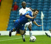 Photo. Andrew Unwin<br /> Leeds United v Birmingham City, Barclaycard Premier league, Elland Road, Leeds 20/09/2003.<br /> Leeds' Salomon Olembe fowls Birmingham City's Damien Johnson.