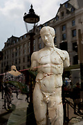 A cast copy of a classical ancient Greek statue of Apollo in a shop window near Piccadilly Circus, on 30th April 2019, in London, England.