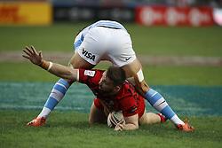 April 6, 2018 - Hong Kong, HONG KONG - Afon Bagshaw (9) of Wales is caught between the ball and Santiago Alvarez (6) of Argentina during the 2018 Hong Kong Rugby Sevens at Hong Kong Stadium in Hong Kong. (Credit Image: © David McIntyre via ZUMA Wire)