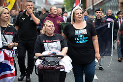 "© Licensed to London News Pictures . 02/06/2018. Manchester, UK. DFLA supporters wearing "" OH TOMMY TOMMY "" t-shirts in reference to jailed EDL founder Tommy Robinson . The Democratic Football Lads Alliance demonstrate at Castlefield Bowl in Manchester , eleven days after the first anniversary of the Manchester Arena terror attack . Photo credit : Joel Goodman/LNP"