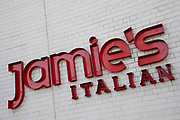 Sign for the food and restaurant brand Jamies Italian in Birmingham, United Kingdom.