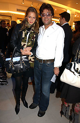 JAG BOLINA and REBECCA VON MEISTER at the launch of Roberto Cavalli Vodka held in the International Designer Room, Harrods, Hans Crescent, London on 5th December 2006.<br /><br />NON EXCLUSIVE - WORLD RIGHTS