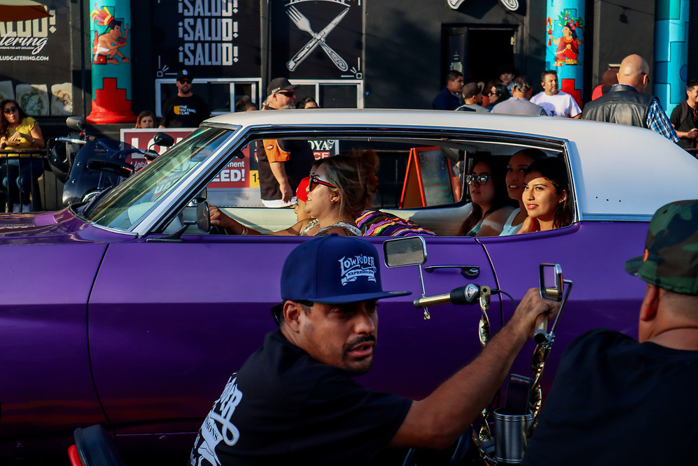 Lowrider enthusiasts cruise down Logan Avenue on Wednesday, June 16, 2021 in Barrio Logan.The La Vuelta Car Cruise is a community lowrider cruise night series happening every other Wednesday during the summer months, concluding with the La Vuelta Summer Festival. The 2020 cruise nights begin on April 29th and repeats every other Wednesday until August 5th. The La Vuelta Summer Festival will be held on August 22nd, 2020, on the 2100 block of Logan Avenue.(Photo by Sandy Huffaker/Redux Pictures)