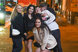 © Licensed to London News Pictures. 29/10/2020. Nottingham, UK. Revellers pose for a picture as they  enjoy a night out in the city centre before new restrictions come into force in Nottingham. The county of Nottinghamshire will enter into Tier 3 ,from 00:01 am on Friday 30 October.  Photo credit: Ioannis Alexopoulos/LNP