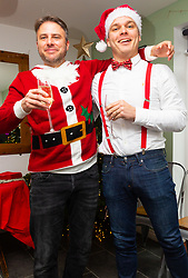 Best of friends Lee and Mike pose for a picture in front of the Christmas tree. Brighton, December 16 2018.