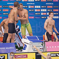 Members of team France Amaury Leveaux, Alain Bernard, Frederick Bousquet and Jeremy Stravius celebrate their victory during the Men's 4x100m Freestyle final of the 31th European Swimming Championships in Debrecen, Hungary on May 21, 2012. ATTILA VOLGYI