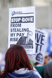 Licensed to London News Pictures 17/10/2013<br /> London. UK. <br /> A teacher on strike marches through central London, protesting against a government's initative to not give teachers a pay rise. <br /> Photo credit: Anna Branthwaite/LNP