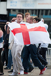 The English Defence League (EDL) return to Sheffield to lay flowers at Sheffield War Memorial . resulting in a police operationlasting over 5 hours involving Officers from Wales, South Yorkshire, Greater Manchester, West Yorkshire, Lancashire and Mersyside Police forces. An EDL Supporter with the Cross of Saint George <br /> <br /> 8 June 2013<br /> Image © Paul David Drabble<br /> www.pauldaviddrabble.co.uk