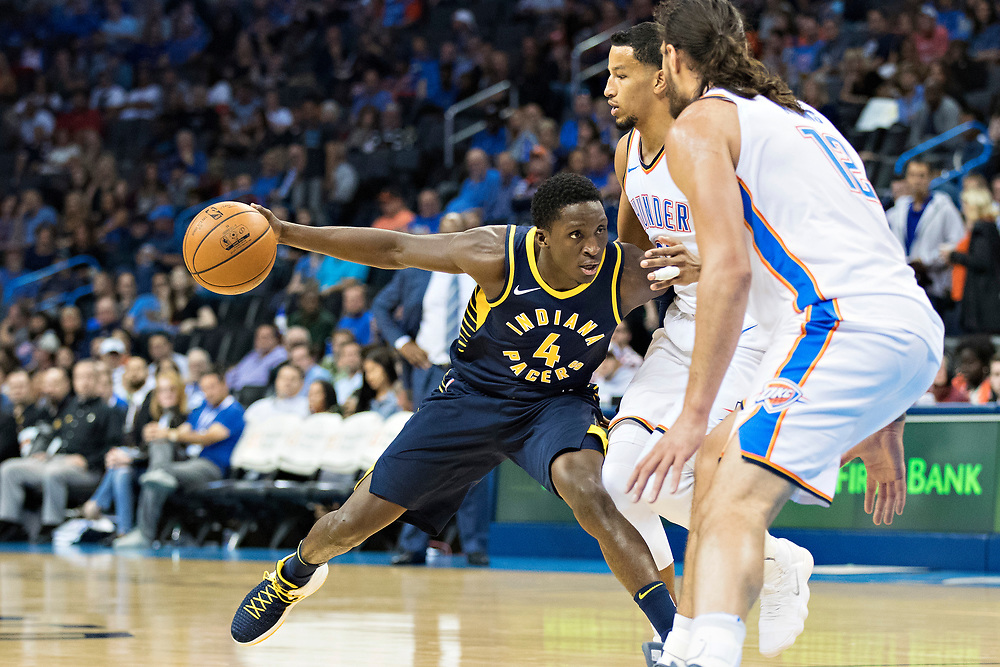 OKLAHOMA CITY, OK - OCTOBER 25:  Victor Oladipo #4 of the Indiana Pacers tries to drive to the basket during a game against the Oklahoma City Thunder at the Chesapeake Energy Arena on October 25, 2017 in Oklahoma City, Oklahoma.  NOTE TO USER: User expressly acknowledges and agrees that, by downloading and or using this photograph, User is consenting to the terms and conditions of the Getty Images License Agreement.  The Thunder defeated the Pacers 114-96.  (Photo by Wesley Hitt/Getty Images) *** Local Caption *** Victor Oladipo