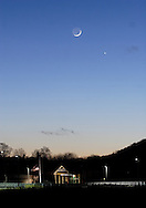 Middletown, N.Y. - The crescent moon and Venus shine in the twilight sky over Maple Hill Elementary School on Jan. 20. 2007.