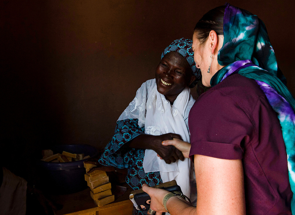U.S. Army Staff Sgt Cana Garrison, with the 411 Civil Affairs Battalion, stationed at Air Base 201, interacts buys handmade soap from a villager near Agadez, Niger on July 1st 2019. The soap was made with supplies and tools donated by the Airmen and soldiers deployed to the local military base outside of the city, Air Base 201.