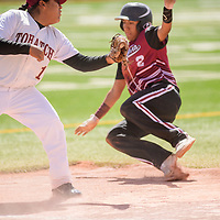 Tohatchi Cougar Nysaiah Sleuth (19) prepares to tag out Magdalena Steer Alec Paez (2) before a slide to third base at the Gallup Sports Complex Thursday.