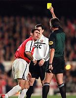Arsenal defender Martin Keown is shown the yellow card by referee Hartmut Strampe. Arsenal 3:2 FC Shakhar Donetsk, UEFA Champions League, Group B, 20/9/2000. Credit: Colorsport / Stuart MacFarlane.