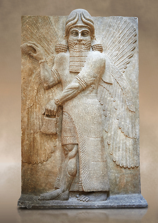 Stone relief sculptured panel of a Genie blessing. Gate No 3, Inv AO 19863 from Dur Sharrukin the palace of Assyrian king Sargon II at Khorsabad, 713-706 BC.  Louvre Museum Room 4 , Paris .<br /> <br /> If you prefer to buy from our ALAMY PHOTO LIBRARY  Collection visit : https://www.alamy.com/portfolio/paul-williams-funkystock/ancient-assyria-antiquities.html  Refine search by adding background colour, place, subject, museum etc into the LOWER SEARCH WITHIN GALLERY box to <br /> <br /> Visit our ANCIENT WORLD PHOTO COLLECTIONS for more photos to download or buy as wall art prints https://funkystock.photoshelter.com/gallery-collection/Ancient-World-Art-Antiquities-Historic-Sites-Pictures-Images-of/C00006u26yqSkDOM