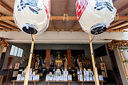 Three large mikoshi, or portable shrines, are displayed in a shrine in Asakusa on the   first day of the three-day Sanja Matsuri, Asakusa, Tokyo, Japan. Friday May 18th 2018. The Sanja matsuri, or festival, takes place over the third weekend of May in the streets around the famous Senso-ji Temple. It lis one of the biggest festivals in Japan and lasts for three days  (May 18th to May 20th) with parades of large mikoshi carried around the streets by crowds of supporters