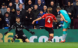 Tottenham Hotspur's Harry Kane (right) scores his side's first goal of the game