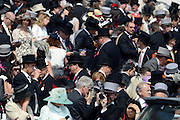 © Licensed to London News Pictures. 02/06/2012. London, UK. Crowds in the Royal Enclosure. HRH Queen Elizabeth at The Investic Derby Festival today 2nd June 2012. The Royal Jubilee celebrations. Great Britain is celebrating the 60th  anniversary of the countries Monarch HRH Queen Elizabeth II accession to the throne this weekend Photo credit : Stephen Simpson/LNP