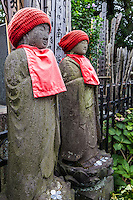"""""""Jizo"""" images and statues are popular in Japan as Bodhisattva who console beings awaiting rebirth as well as comfort for travelers. As such they are often found along roadsides, paths or even street corners. The jizos in this image are at Yanaka Cemetery."""