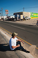 Single spectator sitting near finish of 2012 San Felipe Baja 250, San Felipe, Baja California, Mexico