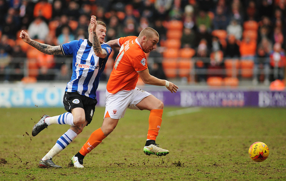 Blackpool's Jamie O'Hara under pressure from Wigan Athletic's James McClean<br /> <br /> Photographer Kevin Barnes/CameraSport<br /> <br /> Football - The Football League Sky Bet Championship - Blackpool v Wigan Athletic - Saturday 28th February 2015 - Bloomfield Road - Blackpool<br /> <br /> © CameraSport - 43 Linden Ave. Countesthorpe. Leicester. England. LE8 5PG - Tel: +44 (0) 116 277 4147 - admin@camerasport.com - www.camerasport.com