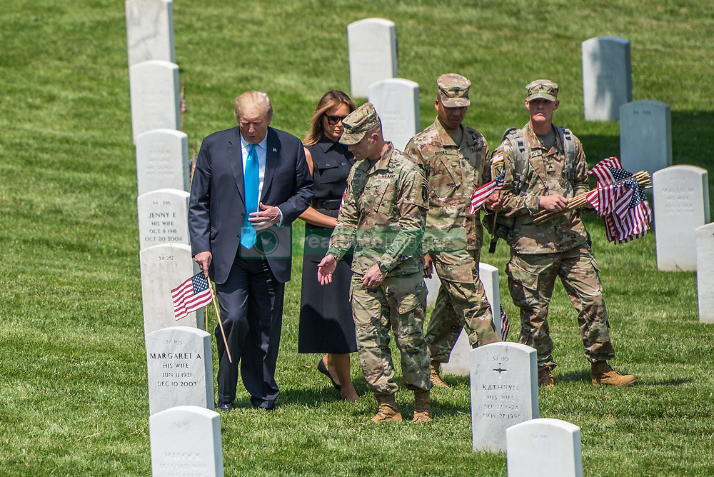 May 23, 2019 - Arlington, VA, United States of America - U.S. President Donald Trump and First Lady Melania Trump assist soldiers with the 3d U.S. Infantry Regiment place flags at headstones during a visit to pay their respect at Arlington National Cemetery at the start of the Memorial Day holiday May 23, 2019 in Arlington, Virginia. (Credit Image: © Nicholas T. Holmes via ZUMA Wire)