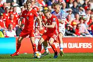 Wales midfielder Matt Smith holds off Slovakia midfielder Juraj Kucka during the UEFA European 2020 Qualifier match between Wales and Slovakia at the Cardiff City Stadium, Cardiff, Wales on 24 March 2019.